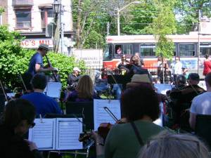 Fiddlers with streetcar in background