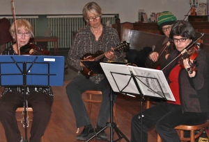 3 fiddlers with mandolin player.