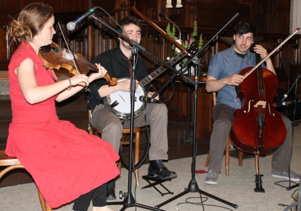 Shoeless performing on stage: Emilyn Stam on fiddle, Frank Evans on banjo , Eli Bender playing cello.
