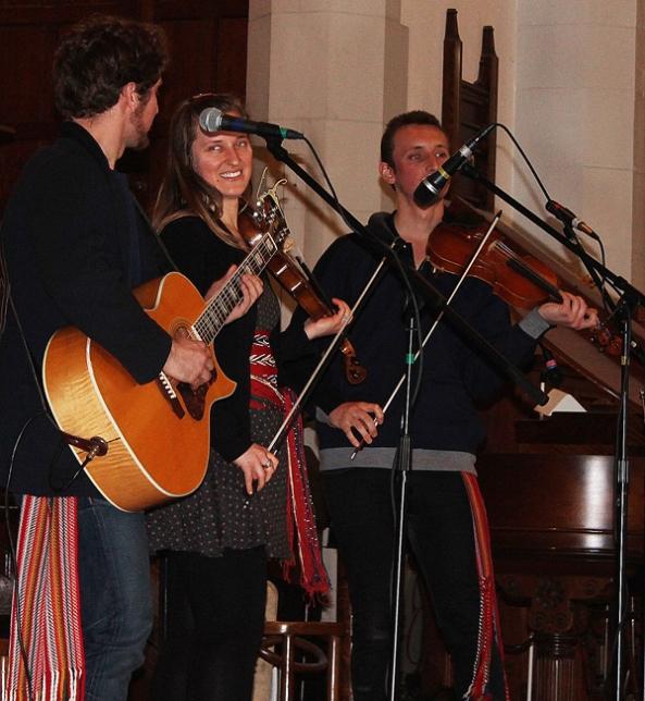 Metis Fiddler Quartet standing on stage.