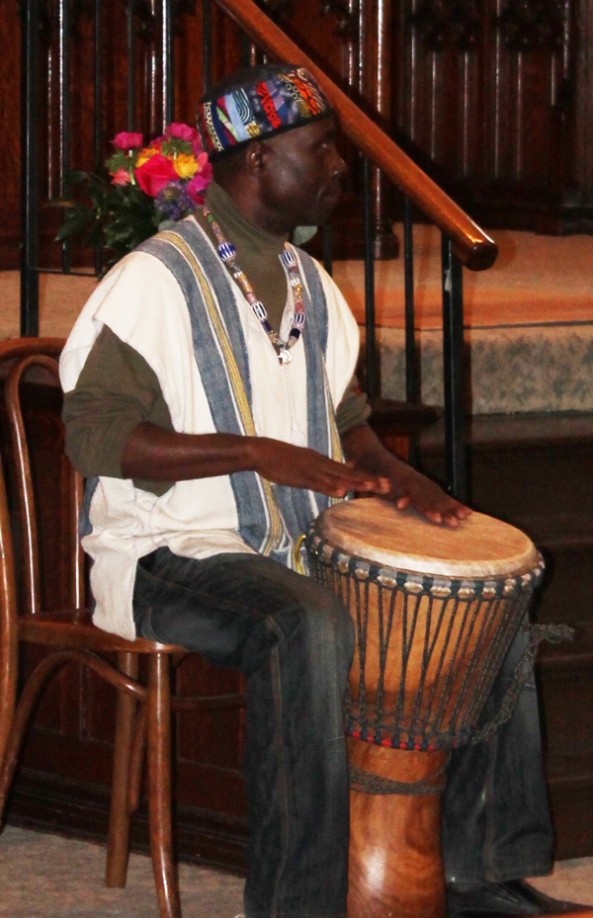 Njacko Backo playing his African hand drum.